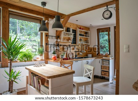 Vintage rustic interior of kitchen with white furniture, wooden wall and rustical decor. Bright indoor with window. Cottage style. #1578673243