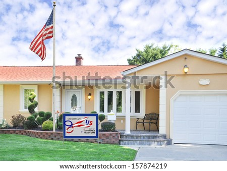 """Government Shutdown Political Message """"DO NOT CUT US OUT OF AFFORDABLE HEALTH CARE"""" on Front Yard Lawn Suburban Home with American Flag"""
