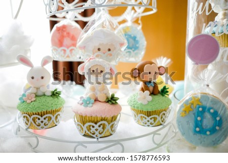 Dessert table for a party. Ombre cake, cupcakes, sweetness ,animal theme - Image