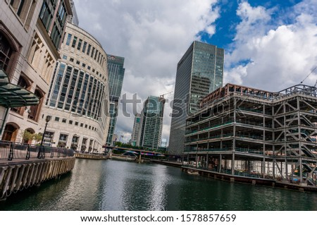 London, UK - 11 June 2019: Canary Wharf, skyscrapers under construction. Canary Wharf, Isle of Dogs. Futuristic glass and concrete buildings. Modern London architecture #1578857659