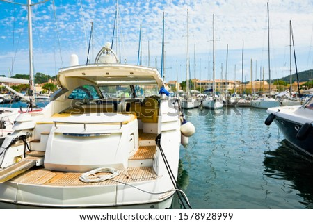 Back view on yacht docking in calm port during summer day #1578928999