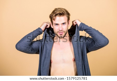 Brute masculinity extremely commanding looking conventionally handsome. Masculinity concept. Masculinity and confidence. Man muscular torso wear hooded clothes. Unconventional but masculine look. #1579125781