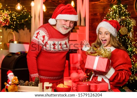 family bonding. family holiday weekend. small girl with santa man. grandfather and grandchild at home. happy new year. father and daughter love christmas. xmas happiness and joy. gift for child. #1579126204