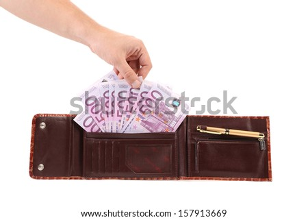 Hand holds euro bills in opened purse. Isolated on a white background. #157913669