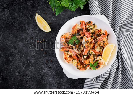 Grilled shrimps. King prawn tails in orange-garlic sauce with parsley. Top view, copy space #1579193464