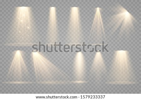 Set of Spotlight isolated on transparent background. Vector glowing light effect with gold rays and beams #1579233337