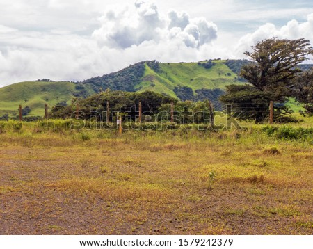Hilly landscape in the north of Costa Rica with its lush vegetation #1579242379