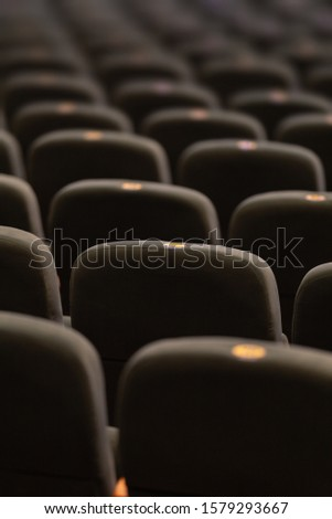 Gray velvet seats for spectators in the theater or cinema #1579293667