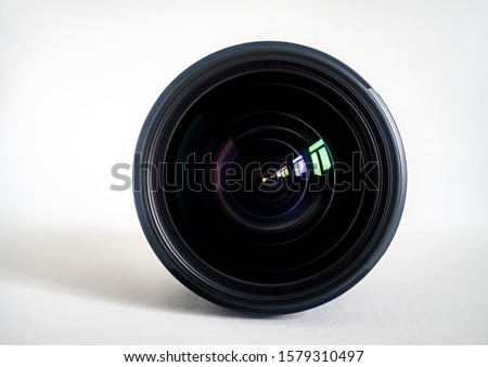 Objective lens of photo camera for photo or video  closeup on white background Royalty-Free Stock Photo #1579310497