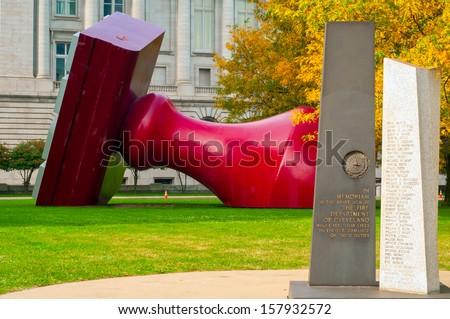 CLEVELAND, OH - OCTOBER 5: A memorial to firemen stands near the Free Stamp sculpture in Willard Park by city hall in Cleveland Ohio, the latter's location since 1991. Photo taken on October 5, 2013. #157932572