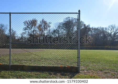 Outside in a park where you can watch a baseball game take place. Picture taken in St. Peters, Missouri on a fall day in November.