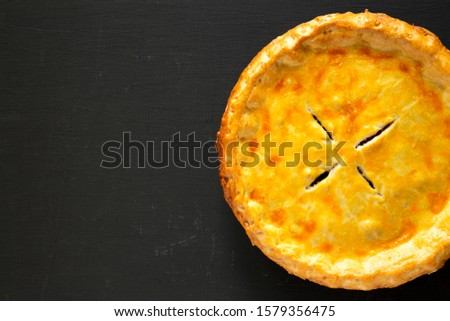 Tasty Homemade Canadian Tourtiere Meat Pie on a black background, top view. Flat lay, overhead, from above. Copy space. #1579356475