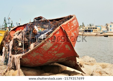Old red boat at the port of Essaouira Morocco