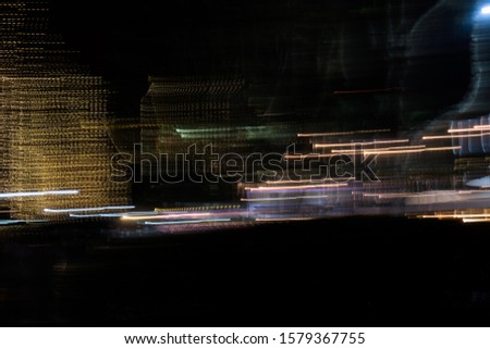 Abstract futuristic line night lights stripes in motion texture motion over dark ultra wide background. blurred lines moving fast #1579367755