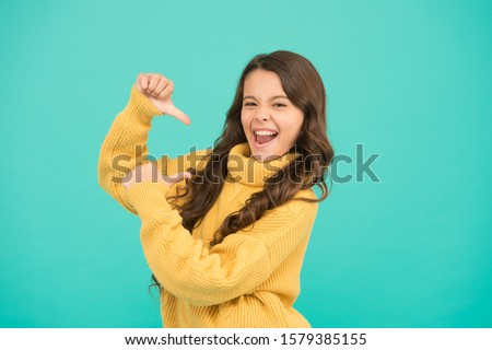 Look at me. Lucky kid. Positivity concept. Emotional baby. Positive child. Positive attitude to life. Positive mood. Kids psychology. Adorable smiling girl wear yellow sweater turquoise background. #1579385155