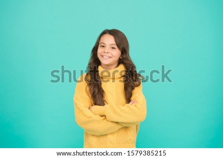 Positive mood. Kids psychology. Adorable smiling girl wear yellow sweater turquoise background. Positivity concept. Good vibes. Emotional baby. Positive child. Positive attitude to life. Inspiration. #1579385215