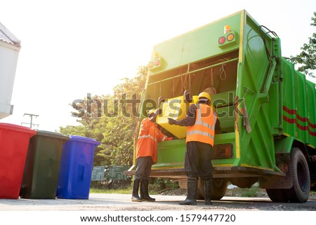 Men who dispose of rubbish that works for public benefit, empty trash container of the Thai Public Health Division in Asia Royalty-Free Stock Photo #1579447720
