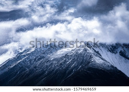 View of the highest Austrian mountain Grossness. An alpine mountain landscape of High Tara with the summit of Grossness. Stalinist ascent route to the summit. Snow, rocks and sharp ridge. #1579469659