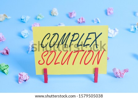 Text sign showing Complex Solution. Conceptual photo significant ideas that are completely or partly repressed Colored crumpled rectangle shaped reminder paper light blue background. #1579505038