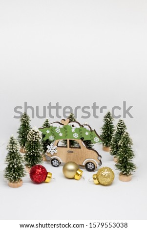 Christmas tree and toy car with lights on white background. Christmas holiday celebration concept. Creative christmas card.Copy space #1579553038