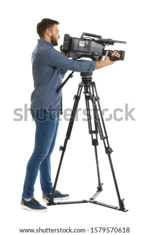 Operator with professional video camera on white background #1579570618