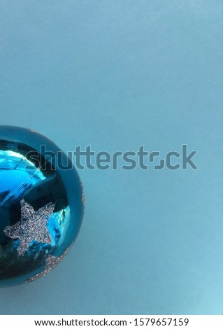 Group of Christmas blue baubles. Baubles with colorful garland on holidays background. Close up. #1579657159