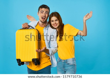 Man and woman with a yellow suitcase lifestyle flight vacation vacation dream #1579710736