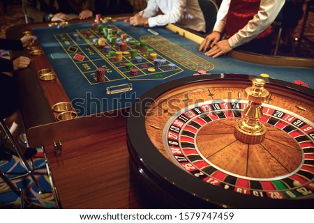 People gambling at roulette poker in a casino. #1579747459