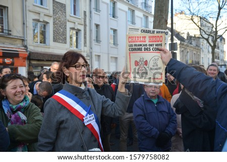 "Tours, France -January 10 2015 :protest after the deadly attack on Charlie-Hebdo's journalists ""I am Charlie"" in Paris #1579758082"