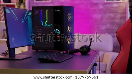 Pc unit un colorful neon lighst for online gaming. Gaming chair #1579759561