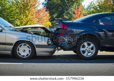 Auto accident involving two cars on a city street Royalty-Free Stock Photo #157986236