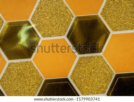 yellow or golden glitter hexagon stickers under foil, cool sticker background texture #1579903741