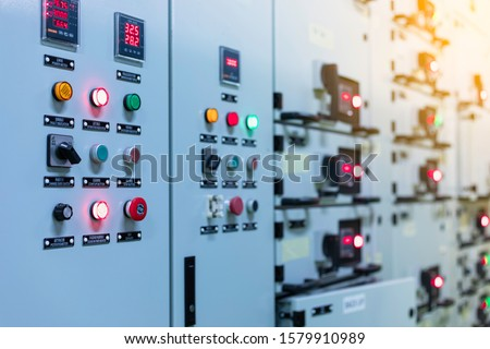 Electrical selector switch,button switch,Electrical switch gear at Low Voltage motor control center cabinet in coal power plant. blurred for background. #1579910989