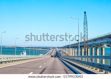 Transport passes over the Crimean bridge in Russia, a railway bridge is being built nearby, which will open soon #1579923043