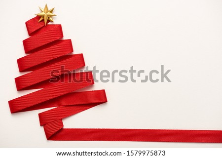 top view of red ribbon with star shape bow isolated on white  #1579975873