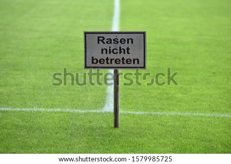 sign with inscription lawn enter forbidden #1579985725