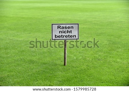 sign with inscription lawn enter forbidden