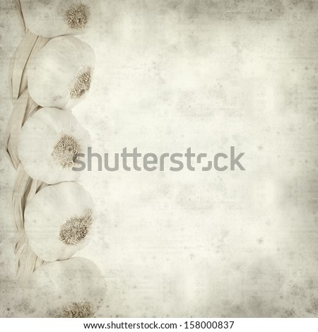 textured old paper background with neat white garlic plait #158000837