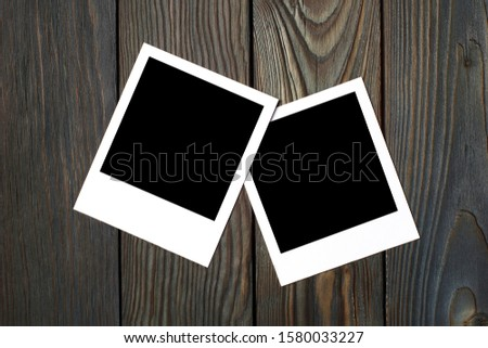 Two square blank photocards on dark wooden background #1580033227