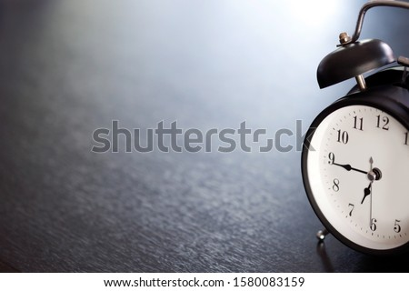 Vintage clocks placed on a black table with space for placing things in the morning. #1580083159