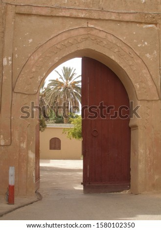 palace gate town gate - one gate wing open morocco #1580102350
