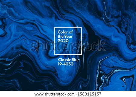 Classic blue color of the year 2020. Bright blue and white marble background. Liquid stripy minimalistic trendy paint texture. Abstract fluid art. Acrylic and oil flow modern creative backdrop Royalty-Free Stock Photo #1580115157