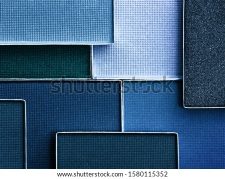 Classic blue palette of eye makeup. Color of the year 2020. Classic blue background. Cosmetics products background in trendy color scheme. Royalty-Free Stock Photo #1580115352