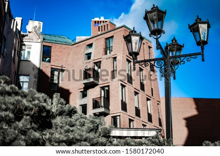 Street lights lamp post lanterns deserted road. Royalty-Free Stock Photo #1580172040