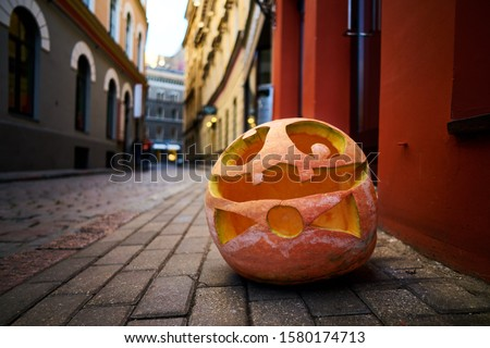 Halloween Pumpkin on old town street in Riga. Royalty-Free Stock Photo #1580174713