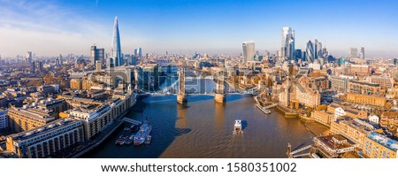 Aerial view of the Tower Bridge in London. One of London's most famous bridges and must-see landmarks in London. Beautiful panorama of London Tower Bridge. #1580351002