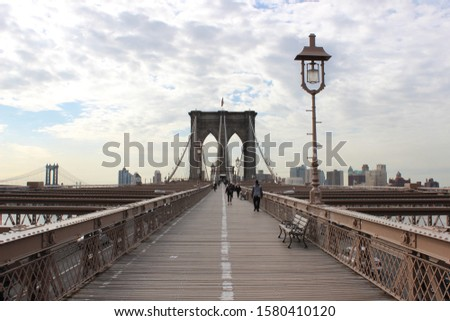 NEW YORK - JUNE 2: Views of the Brooklyn Bridge on a summer day on June 2, 2015. Its a famous and iconic bridge in New York, which passes the east river.