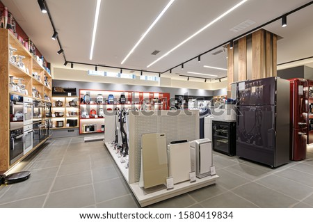 Fridges, heaters and and vacuum cleaners in the premium home appliance store #1580419834