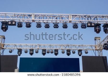 Temporary outdoor stage and lighting equipment. #1580485396