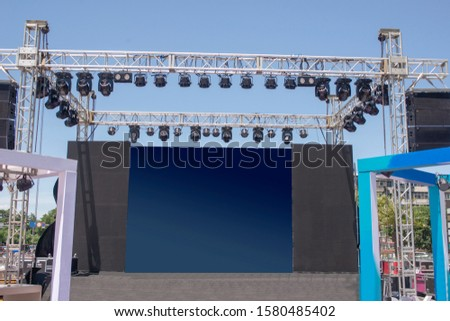 Temporary outdoor stage and lighting equipment. #1580485402
